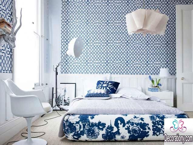 bedroom decorated in white and blue