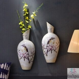 Living room decorating wall with hanged vases