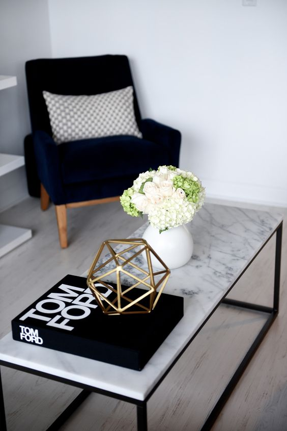 Marble trendy table with copper decoration - home decor trends 2017