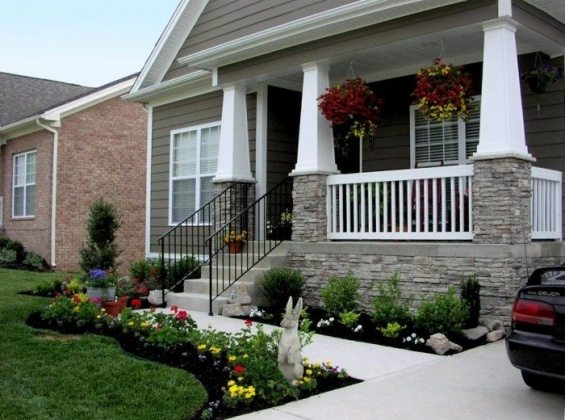 A-Beautiful-House-With-White-Stamped-Concrete-Walkways-For-Front-Yard-Hardscaping-Design-700x520