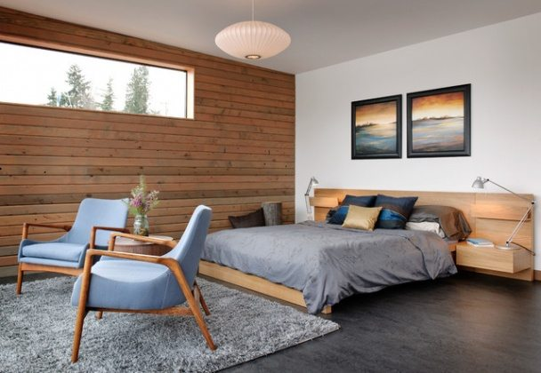 Modern-Grey-Bedroom-Rug-with-Upholstered-Chair-and-Wooden-Sidieboard