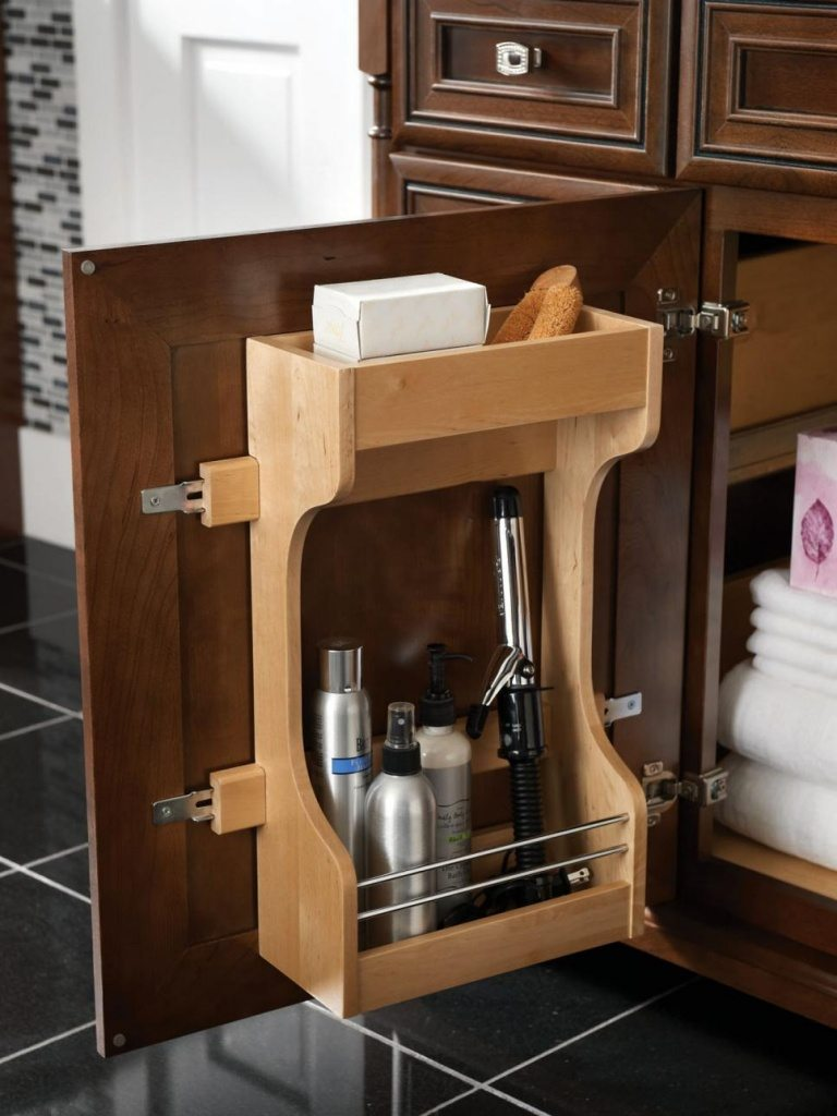 invest in small storages hidden storage inside bathroom cabinet