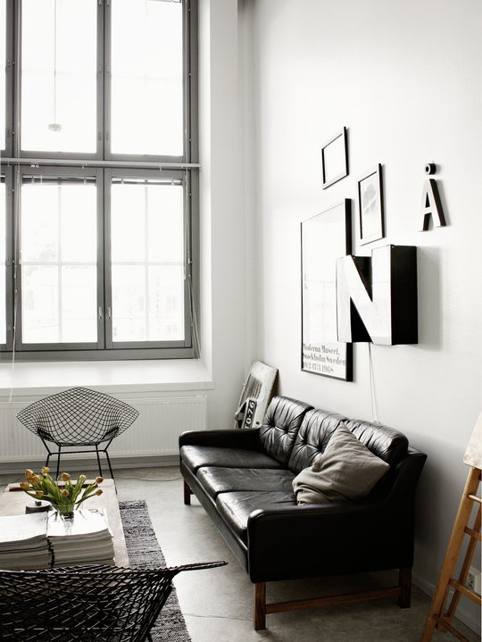 stylish mid century living room with black and white