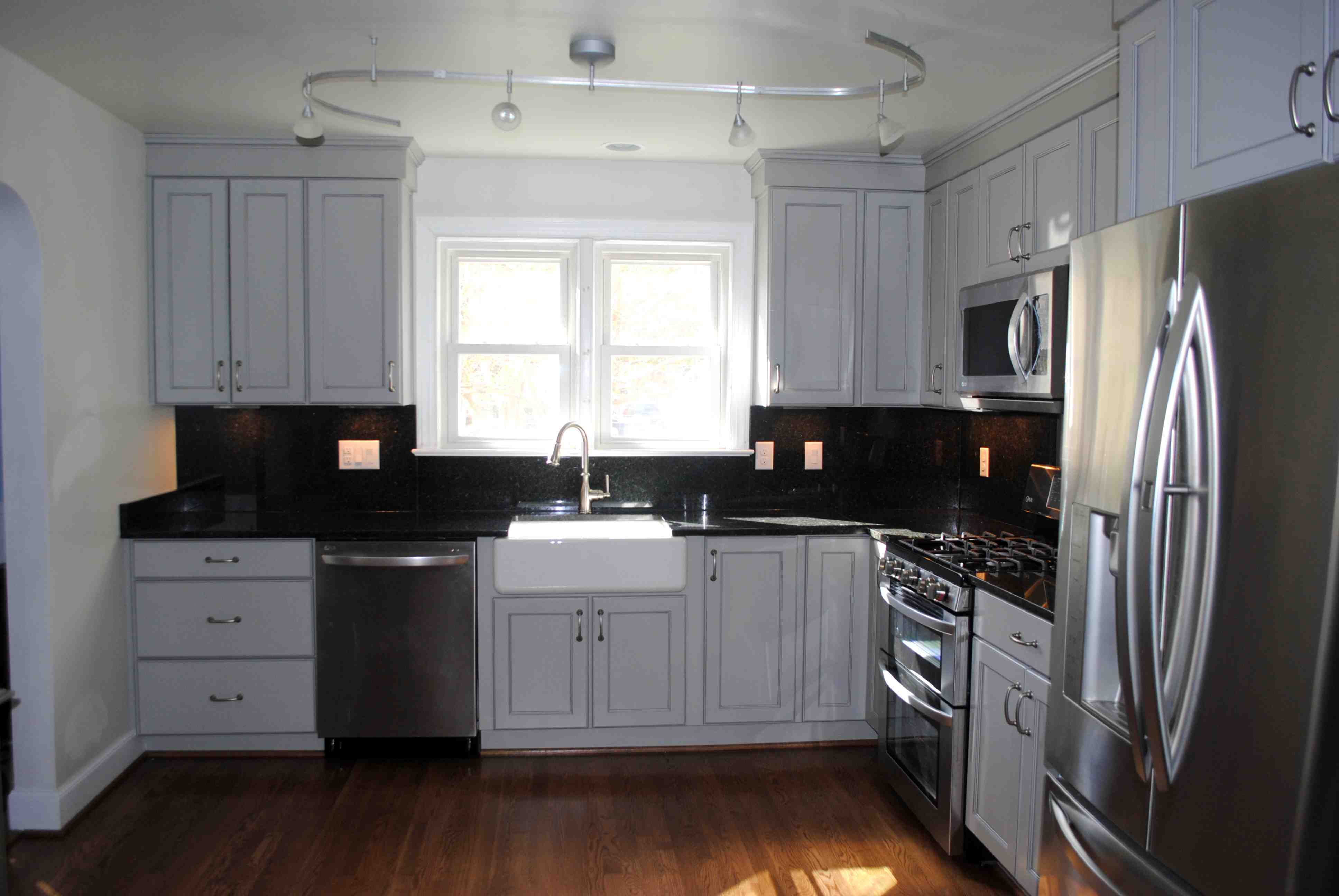Rustic Kitchen Cabinets - Cozy kitchen area of a small private house